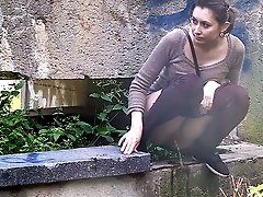 0  - Pretty brunette pisses while squatting outside
