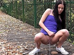 0  - Gorgeous raven haired girl pisses on wooden path