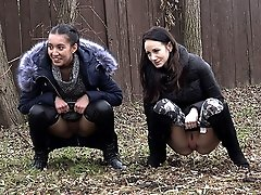 0  - Gorgeous girls simultaneously piss outside