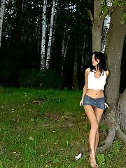 16 pictures - Sexy brunette teen peeing in the country park